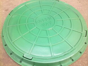 Канализационный люк. зеленый